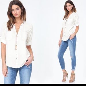 White/ light cream Bebe blouse with chain. Small.
